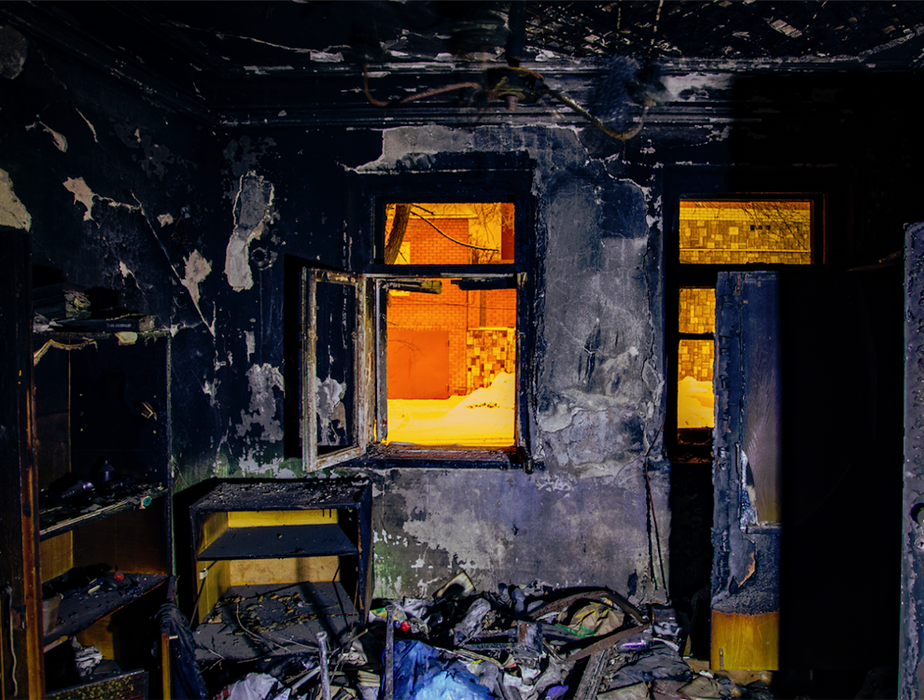 fire damaged house with burnt interior