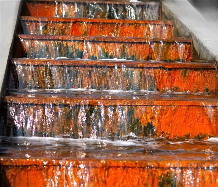 A set of stairs with water flowing down them.