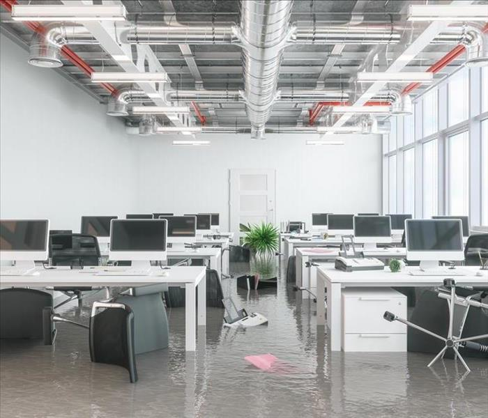 office furnishings and computers with water covering the floor