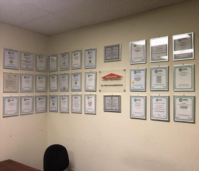IICRC Certificates in frames on the wall.