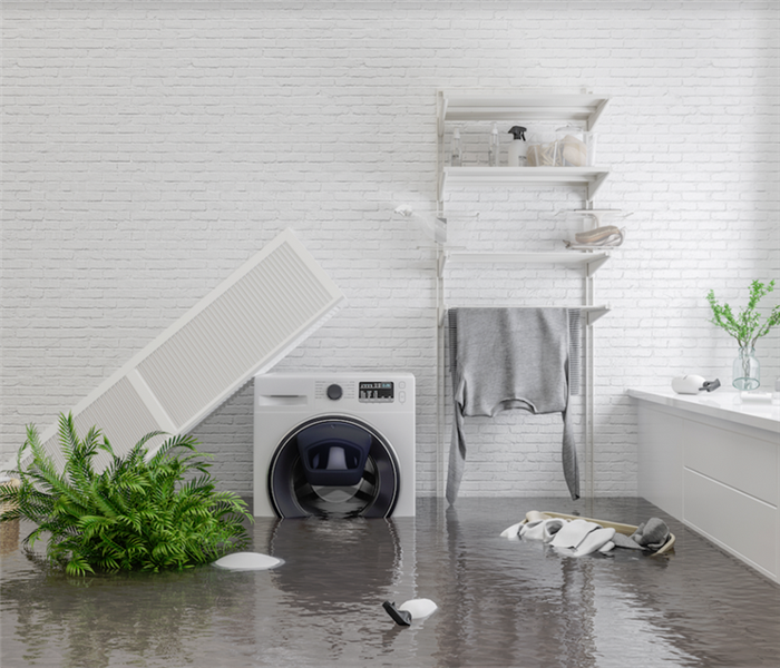 a flooded laundry room with items floating everywhere