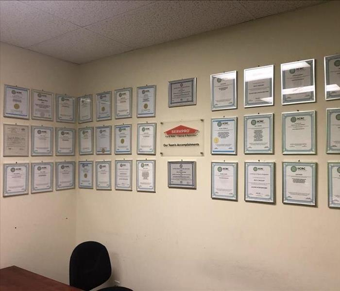plaques on two walls, servpro